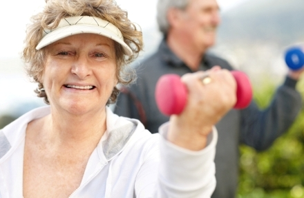 Senior woman doing exercise with a dumbell